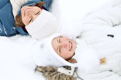 Happy family lies on the snow in winter and looking upwards Stock Photo