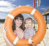 Happy family with life buoy. Stock Photo