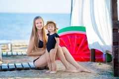 Happy family lifestyle. Relaxing and enjoying life. Bright colors. Top view Young mother with cute daughter Summer travel, water. Sport outdoor activities royalty free stock photography