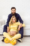 Happy family lifestyle. Young couple are expecting a baby. Stock Image