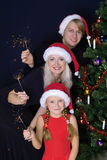 Happy family with lights. Happy christmas family with sparkles fireworks Royalty Free Stock Photos