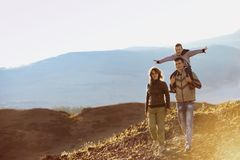 Happy family walking nature mountains area stock image