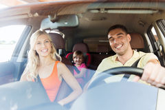 Happy family with little child driving in car Stock Photo