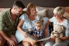 Family with little child having fun with grandma stock photos
