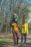 Happy family and little child with paper plane enjoy free time outdoor, freedom concept. Freedom of movement. We are. Happy family and little child with paper royalty free stock photography