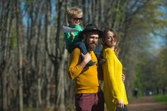 Happy family and little child with paper plane enjoy freedom outdoor. Freedom of movement. Happiness is free.  royalty free stock images