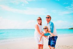 Happy family with little daughter play on beach. Happy family with little daughter play on tropical beach royalty free stock image