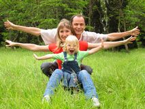 Happy family with little girl Royalty Free Stock Photos