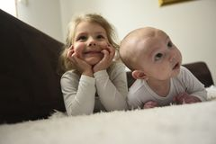 Little girl and her baby brother royalty free stock photography