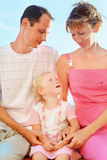 Happy family with little girl near to sea Stock Photography