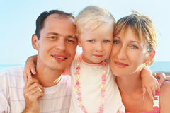 Happy family with little girl near to sea Royalty Free Stock Photo
