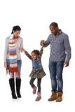 Happy family with little girl walking Royalty Free Stock Images