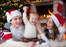 Happy family with little son lying near Christmas Royalty Free Stock Photos