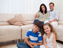 Happy family in the living room Stock Photos