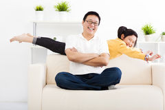 Happy family in living room Royalty Free Stock Images