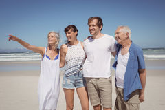 Happy family looking away while standing side by side Stock Photos