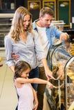 Happy family looking at bread Stock Photo
