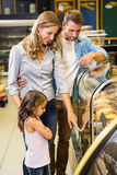 Happy family looking at bread Royalty Free Stock Image