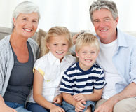 Happy family looking at the camera Stock Photo