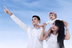 Happy family looking at copyspace Stock Photos