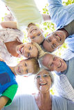 Happy family looking down the camera. On a sunny day Royalty Free Stock Photo