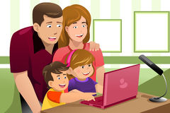 Happy family looking at a laptop. A vector illustration of happy family looking at a laptop Royalty Free Stock Images