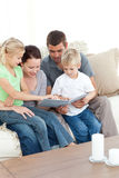 Happy family looking at a photo album Stock Image