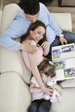 Happy family looking photos at home Stock Photos
