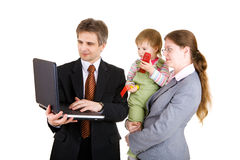 Happy family looking into the screen of laptop Stock Photos