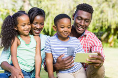 Happy family looking a smartphone Stock Photo