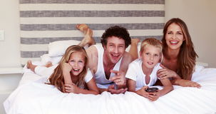 Happy family looking tv stock footage