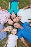 Happy family looking up the camera Royalty Free Stock Photo