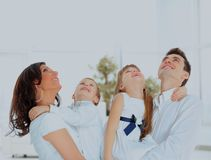 Happy family looking up and smiling. Happy family looking up and smiling Stock Photography