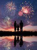 Family looks beautiful fireworks Stock Images