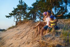 Happy family looks into the distance. Adventure or travel and tourism concept Royalty Free Stock Photography
