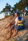 Happy family looks into the distance. Adventure or travel and tourism concept Stock Photo