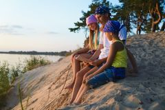 Happy family looks on map. Adventure or travel and tourism concept Royalty Free Stock Image