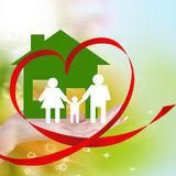 Happy Family.Love. Concept.Hands holding a paper Home on abstract green background Stock Photo