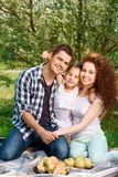 Happy family on a lunch in the park Stock Photo
