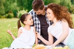Happy family on a lunch in the park Stock Images