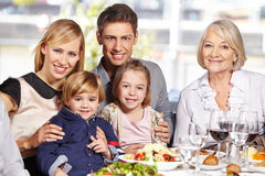 Happy family at lunch table Stock Photos