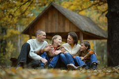 Happy family lying in autumn park Royalty Free Stock Images