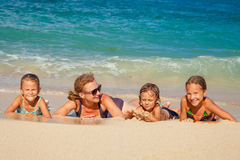 Happy family lying on the beach stock image