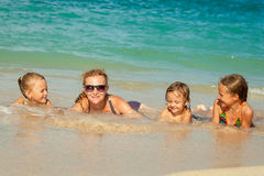 Happy family lying on the beach Royalty Free Stock Photography