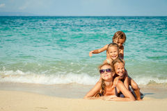 Happy family lying on the beach royalty free stock image