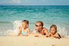Happy family lying on the beach Stock Photo