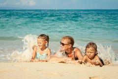 Happy family lying on the beach Stock Photo