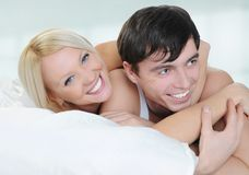 Happy family lying in bed Royalty Free Stock Photos