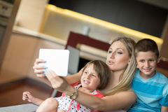 Young Family Using A Tablet To Make Future Plans Royalty Free Stock Photo