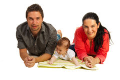 Happy family lying down Stock Photos